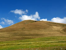 Hill and blue sky Stock Images
