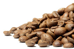 Hill of brown coffee beans isolated on white Royalty Free Stock Image