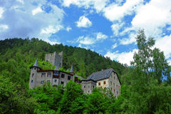 Hill castle Fernstein. The Fernstein Castle seated on a forested hill and its ruinous tower house in the background. A tourist attraction in Tyrol, Austria Royalty Free Stock Photography