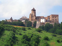 A hill with the castle of Lubovna, Slovakia. A summertime view of a green hill with the castle of Lubovna, Spis region, Slovakia. This castle was built in the royalty free stock photo