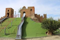 Hill with castles on top. Hill in children s park with castles on top of where slides go down stock image