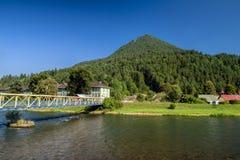Hill Cebrat in town Ruzomberok, Slovakia. Hill Cebrat in town Ruzomberok and river Vah at Slovakia royalty free stock images