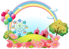 A hill with circus tents, balloons and a ferris wheel Royalty Free Stock Photos