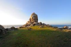 Hill on coastline Stock Photo