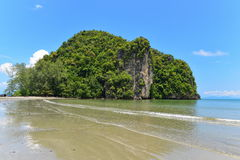 Hill covered in trees at the edge of a beach at Krabi Stock Photos