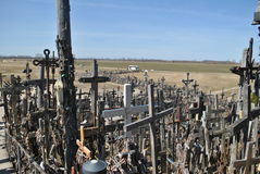 Hill of Crosses, Å iauliai, Lithuania. Hill of Crosses, near city Å iauliai in Lithuania is very famous places, where on old mass grave people brings a stock photos