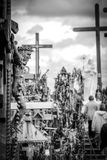 Hill of Crosses, near Siauliai, Lithuania, detail. BW photo of detail of the crucifix, in the background the hill Royalty Free Stock Photography