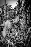 Hill of Crosses, near Siauliai, Lithuania, detail. BW photo of detail of the crucifix, in the background the hill Stock Photo
