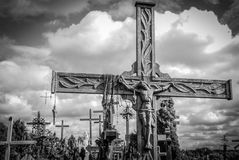 Hill of Crosses, near Siauliai, Lithuania, detail. BW photo of detail of the crucifix, in the background the hill Royalty Free Stock Image