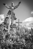 Hill of Crosses, near Siauliai, Lithuania, under the statue. Under a statue between crosses near Siauliai, Lithuania Stock Photography