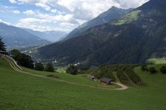 Hill and dale. Mountain village in the Alps; Italy (South Tyrol), summer 2006 royalty free stock images