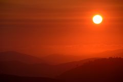 Hill End Sunrise. Red sunrise over mountains due to bush fires burning in the local area Royalty Free Stock Image