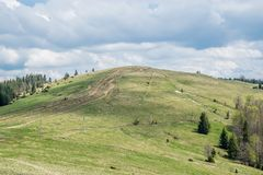 Hill for extreme off-road rides. Lots of tire tracks and thick woods around. Resort town Yaremche in Carpathian Mountains, Western Ukraine royalty free stock photography