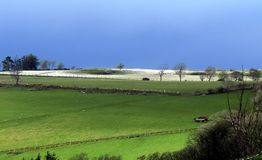 Hill farming in winter, Wales. Snow on a hillside in Wales, the stress of livestock farming in winter Royalty Free Stock Photo
