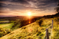 Hill fence sunset Royalty Free Stock Photos