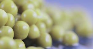 Green peas in bulk. Hill of green peas canned bulk stock video