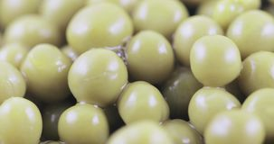 Green peas in bulk. Hill of green peas canned bulk stock footage