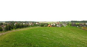 Hill and homes in summer, Lithuania Royalty Free Stock Photo