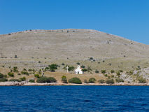 Hill in Kornati island Croatia with church Stock Images
