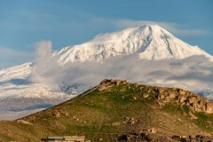 Hill landscape with Ararat mountain at background. Hill landscape at morning in Armenia with Ararat mountain at background. View on Turkey from Armenia royalty free stock photography