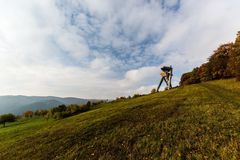 Mountain meadow with lookout tower Stock Photo