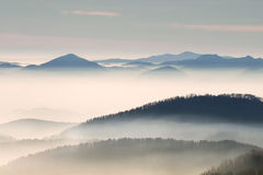 Hill landscape with fog Stock Image
