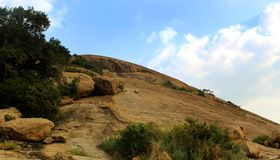 The hill landscape of sittanavasal cave temple complex. Wonderful tropical hill landscape of sittanavasal cave temple complex. Sittanavasal is a small hamlet in royalty free stock photos