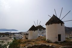 Gre, the island of Ios, two windmills overlooking the sea. stock photo