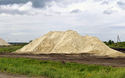 Hill of the mined sand, piled in a sand quarry Royalty Free Stock Photography