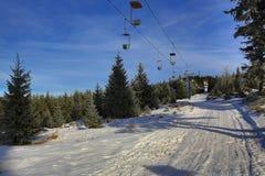 Hill Pancíř, Cloudes and trees, winter landscape in Šumava in Železná Ruda, czech republic Stock Photos