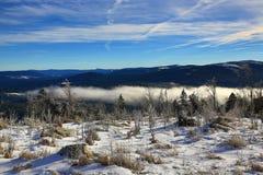 Hill Pancíř, Cloudes and trees, winter landscape in Šumava in Železná Ruda, czech republic Stock Photo