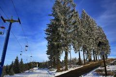 Hill Pancíř, Cloudes and trees, winter landscape in Šumava in Železná Ruda, czech republic Royalty Free Stock Image