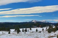 Hill Rachel (Germany), cloudes and trees, winter landscape in Šumava in Filipova Huť, Czech republic Stock Photo