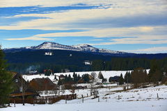 Hill Rachel (Germany), cloudes and trees, winter landscape in Šumava in Filipova Huť, Czech republic Royalty Free Stock Photography
