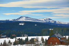 Hill Rachel (Germany), cloudes and trees, winter landscape in Šumava in Filipova Huť, Czech republic Royalty Free Stock Image