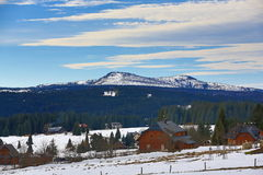 Hill Rachel (Germany), cloudes and trees, winter landscape in Šumava in Filipova Huť, Czech republic Stock Photography
