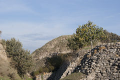 Hill with the ruined houses. Two hills and partly preserved walls of the houses in Troy, Turkey Stock Photo