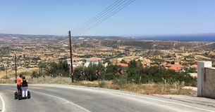 Hill scene with road leading into it . Cyprus. A road leading into a hill scene Stock Image