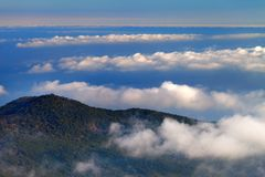 Hill and sea in clouds Stock Photography
