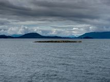 Hill with Seals from Ferry towards Whittier in Alaska United Sta. Photo taken in Alaska, United States of America stock photography