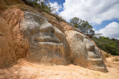 Hill side statues in Colombia. Faces carved in the road side hill at the entrance of Silvia, Colombia Stock Photo