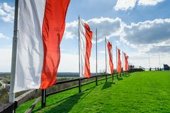 Hill and sky with clouds. And polish flag Stock Image