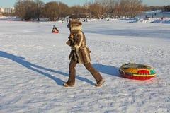 Hill sliding on tubes in winter. Kolomenskoye, Moscow. Royalty Free Stock Photo