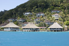 Hill slope by the sea and lodges on a slope. Polynesia. Stock Photo