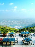 Hill Station Restaurant. A beautiful view of a hill station restaurant with the view of a big city in the backdrop Royalty Free Stock Photography