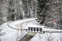 Hill. Tight corner uphill  on a snowy road Stock Image