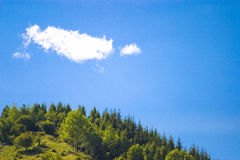 Hill top. Scenery with blue sky and clouds royalty free stock photo