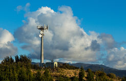 Hill Top Transmission Tower. Transmission tower on a hill top with communication transmitters on it stock photography
