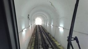 Hill Tram. Going down through the tunnel stock video footage