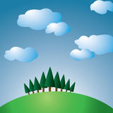 Hill with trees. And sky with clouds Stock Image